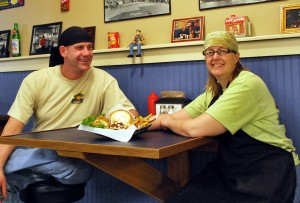 Rich & Kirsten Shellene pictured with a Coleslaw Burger and hand-cut fries