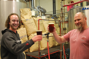 Cody Carter and Jeff Van Horn raise a glass of Moab Brewery beer.