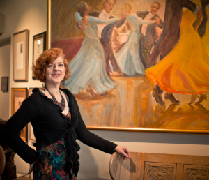 "Karen, standing in front of her painting ""Enchanted Evening at the Viennese Ball"""