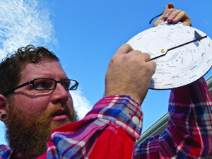 Matthew Allard demonstrates his astroglade, which helps pinpoint the sun for his pinhole camera.