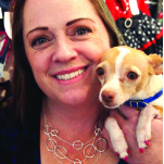 PoshPaws owner Courtney Green with Daisy.