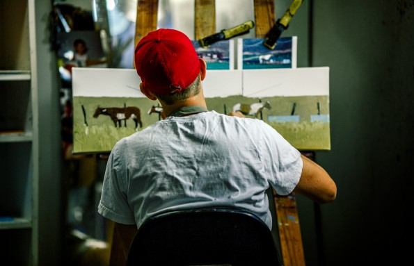 Jeff Pugh paints a landscape in his studio