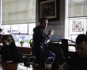 Jonny Gorenstein sips a latte at Sugarhouse Coffee and using the free-ish WiFi.
